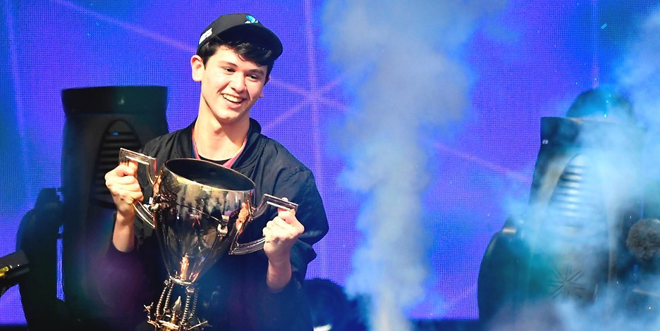 Bugha holding Fortnite World Cup trophy after decisive victory
